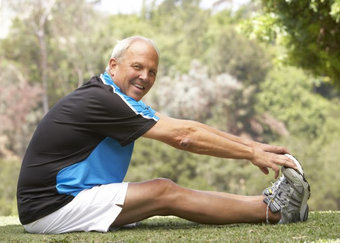 @Glowimages: Senior Man Exercising In Park